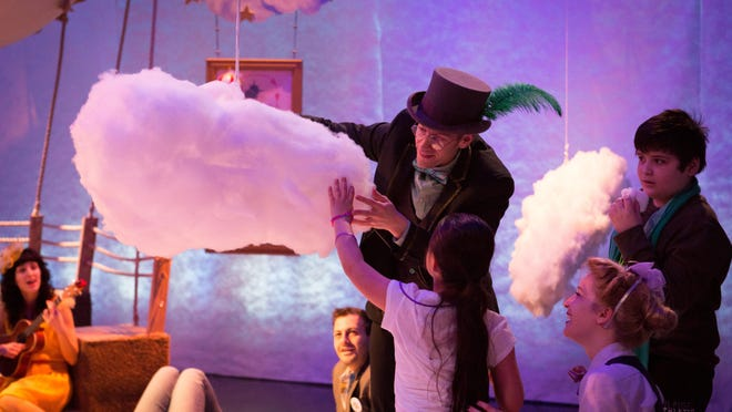 """In """"Up and Away,"""" a Trusty Sidekick Theater Co. production commissioned by Lincoln Center Education, an audience of eight on the autism spectrum follows the story of """"Around the World in Eighty Days."""" Here, an audience member adds the baby cloud she has cared for to a larger cloud."""