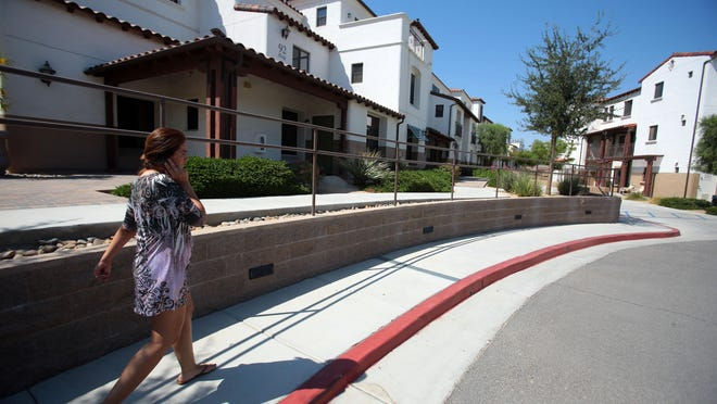 Melissa Mattar walks to her apartment at Wolff Waters Place, an affordable apartment complex in La Quinta.