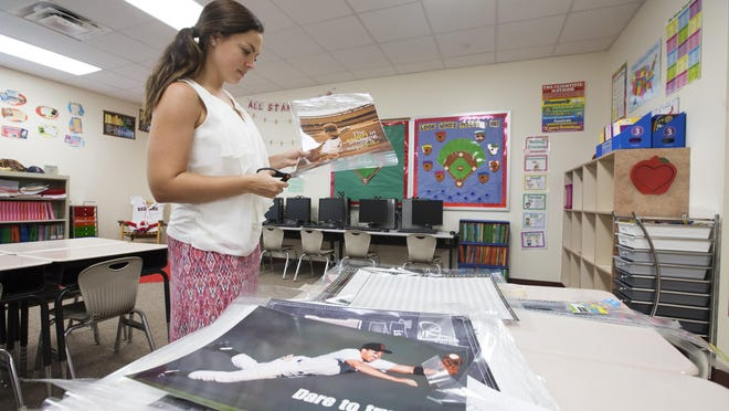 Mariah Washington, a third-grade teacher at Bayshore Elementary School in North Fort Myers, prepares her classroom for the upcoming school year.