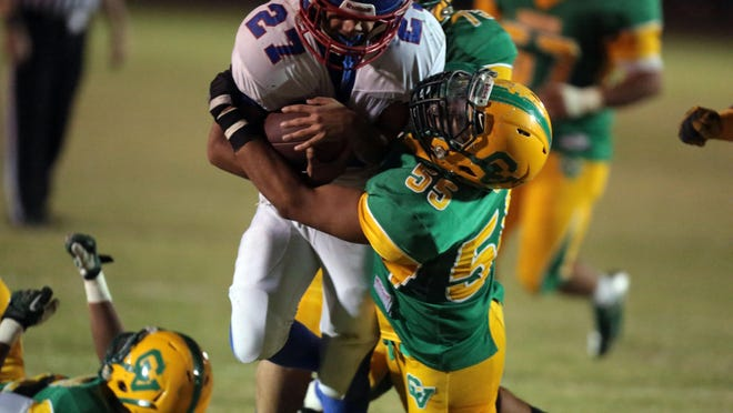 Coachella Valley and Indio play their annual battle for the Bell rivalry game on Friday, November 7, 2014 in Thermal.
