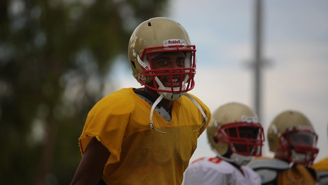College of the Desert quarterback Steven Johnson practices with his team on Tuesday.