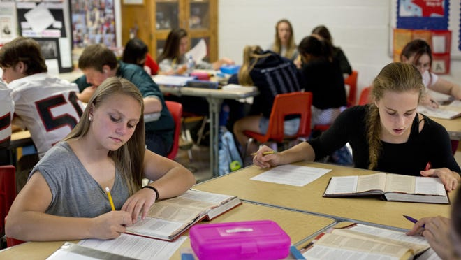 Sophomores Noelle Fleury and Madeline Trombly work together during an AP U.S. Government class Thursday, September 24, 2015 at Port Huron High School.
