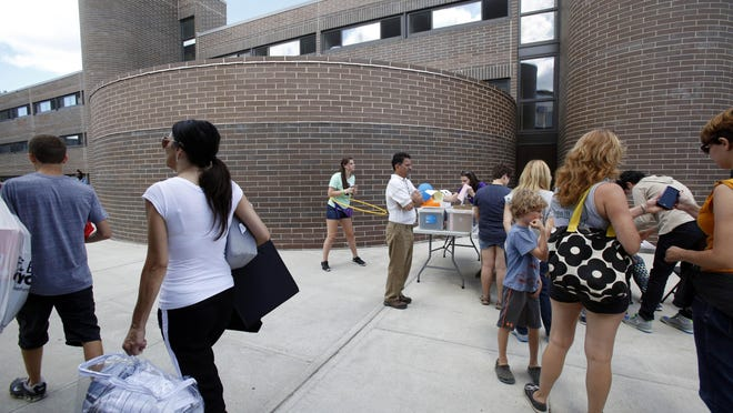 Students move into the dorms at Purchase College, State University of New York, Aug. 28, 2015.