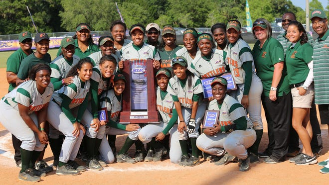 The Florida A&M softball team, right, poses for a photo after winning the MEAC championship.