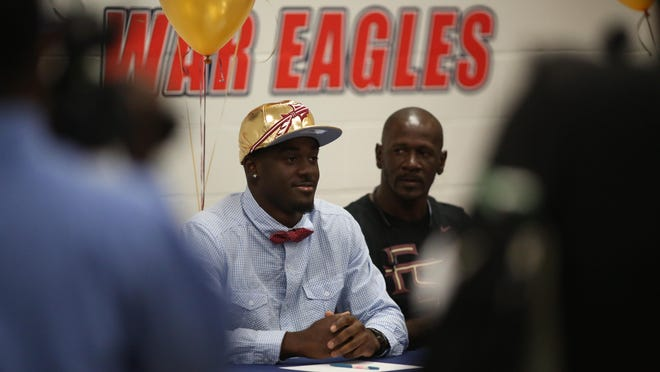 Wakulla High wide receiver Keith Gavin, a four-star recruit, sits content after signing with Florida State during a national signing day ceremony, Feb. 3, 2016.