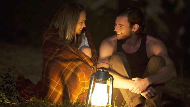 "Gabby Holland (Teresa Palmer) and Travis Shaw (Ben Walker) in ""The Choice."""