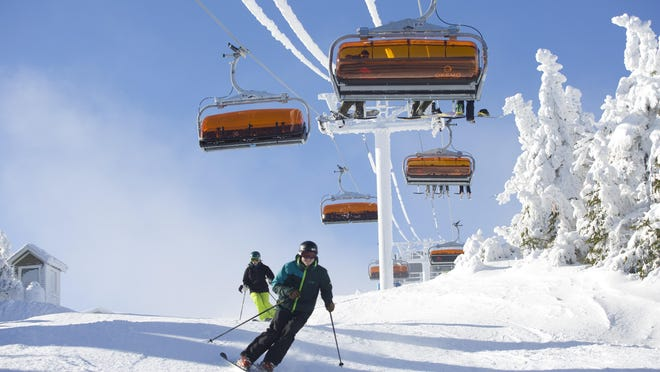 Skiers head up the and down the slopes at Okemo Mountain Resort, owned by Vail Resorts.