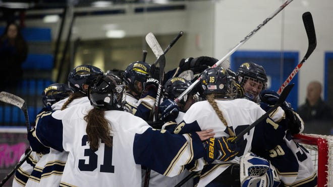 The Essex Hornets celebrate their victory over the Rutland Raiders in the D-I girls hockey semifinal on Wednesday in Essex.