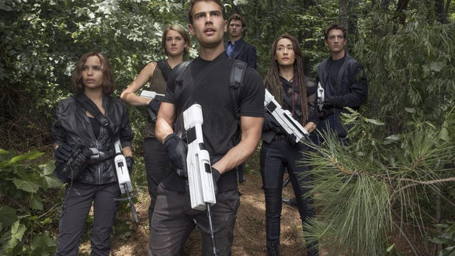 """Zoe Kravitz (from left), Shailene Woodley, Theo James, Ansel Elgort, Maggie Q and Miles Teller are seen in """"The Divergent Series: Allegiant."""""""