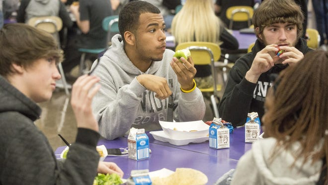 Students eat lunch Monday afternoon inside Central High School's cafeteria.