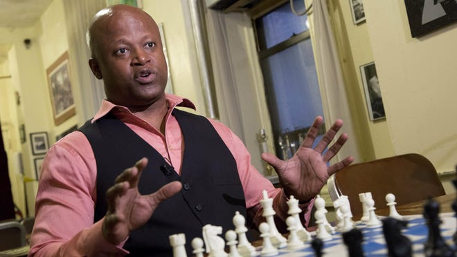 Chess grandmaster Maurice Ashley talks during an interview last week at Chess Forum in New York. The Brooklyn resident has been inducted to the World Chess Hall of Fame in St. Louis.