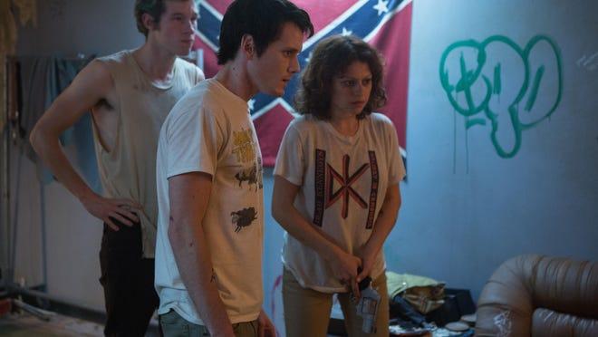 "Callum Turner, Anton Yelchin and Alia Shawkat in ""Green Room."""