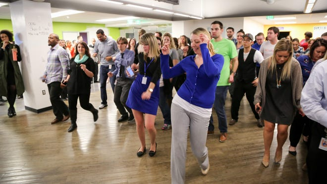 United Shore employee Cristin Lazzaro leads the company's 3 o'clock dance party.