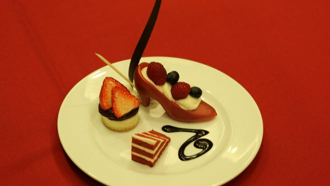 At the 2016 Red Shoe Gala, annual fundraiser for Ronald McDonald House Reno, Atlantis executive pastry chef Kayline Johnson is sending out red chocolate shoes filled with white chocolate and berries.
