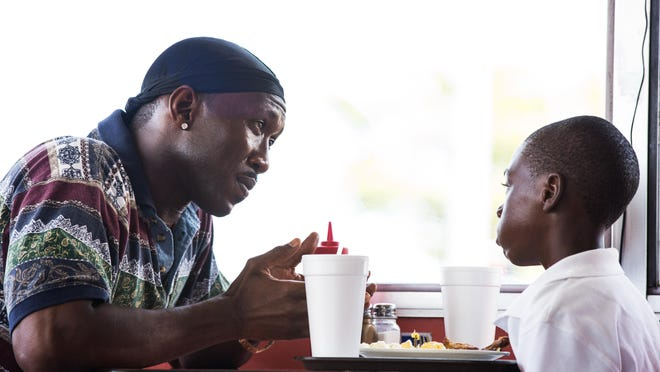 "Mahershala Ali (left) and Alex Hibbert star in Barry Jenkins' ""Moonlight."""
