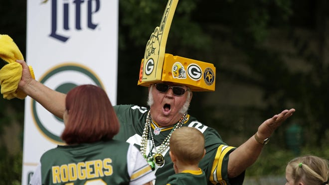 """Eugene Greening, better known as """"Mean Gene,"""" is a fixture at Packers games and at the weekly Clubhouse Live at the Radisson Paper Valley Hotel."""