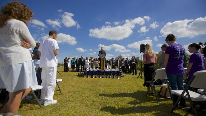 The Rev. McManus leads Ave Maria students and staff in a prayer at the site of the groundbreaking Friday.