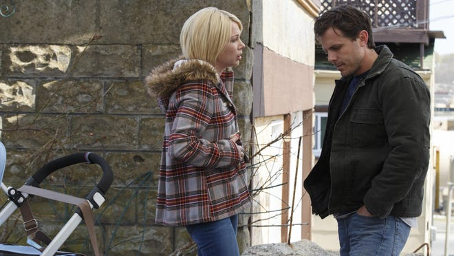 """This image released by Roadside Attractions and Amazon Studios shows Michelle Williams, left, and Casey Affleck in a scene from """"Manchester By The Sea."""" Williams was nominated for a Golden Globe award for best supporting actress for her role in the film on Monday, Dec. 12, 2016. The 74th Golden Globe Awards ceremony will be broadcast on Jan. 8, on NBC. (Claire Folger/Roadside Attractions and Amazon Studios via AP)"""