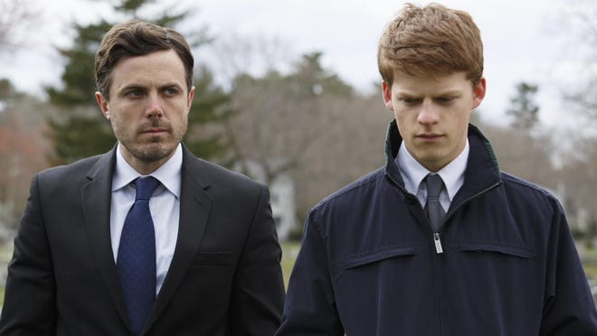 """Lucas Hedges, right, and Casey Affleck in a scene from """"Manchester By The Sea."""" The film opens Thursday at regal West Manchester Stadium 13 and Friday at R/C Hanover Movies."""
