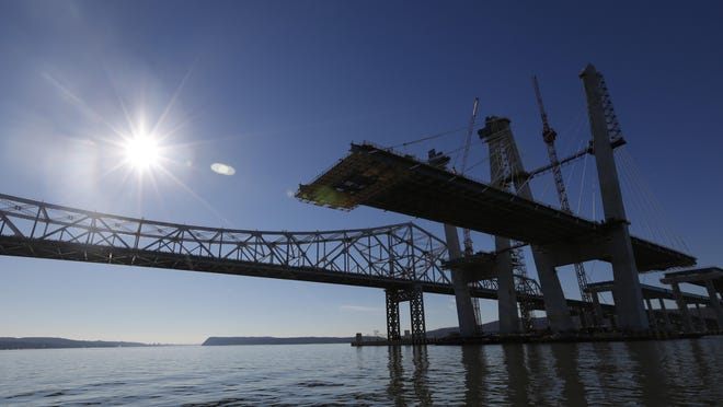 The new Tappan Zee Bridge is seen on the right with the old one in the back.