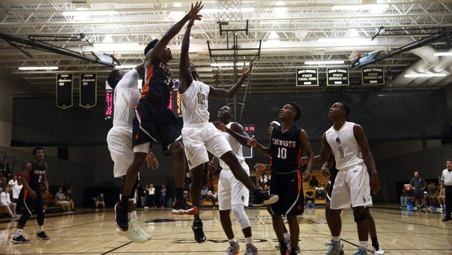 Golden Gate senior Patrick Volcy and Nashville Ensworth senior Jordan Bone jump for the rebound during the championship game of Gulfshore Holiday Hoopfest at Golden Gate High School on Dec. 30, 2015. Ensworth won with a final score of 67-53.