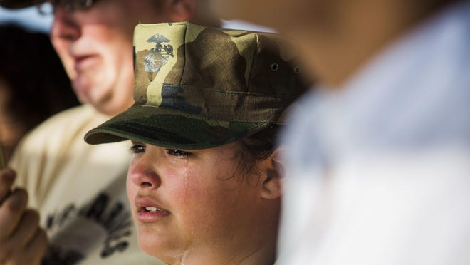 Selena Barlow, 11, cries for Naples Marine Austin Ruiz, her cousin, during his service Sunday.