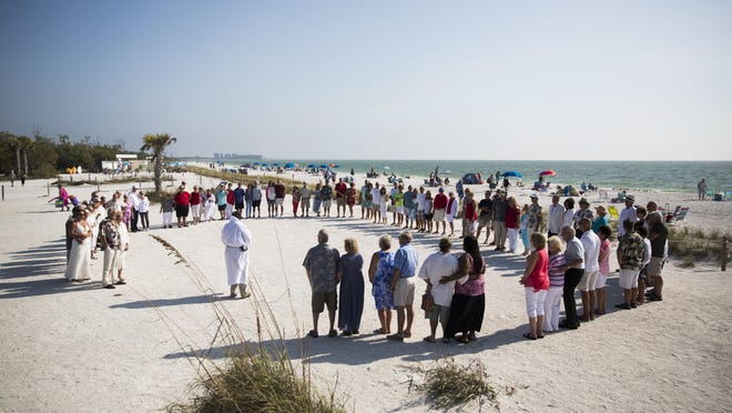 Couples gather to renew their vows at Lovers Key.