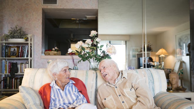 """Estella """"Lea"""" Crossett and her husband, Christopher Crossett, discuss their first date and the time when he was away during World War II in their home in North Naples on Tuesday."""