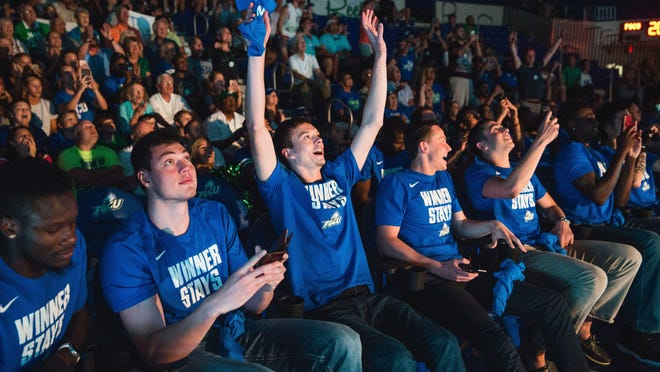 The FGCU men's basketball team reacts in Alico Arena on Sunday after the announcement of their opponent — Florida State — in the NCAA tournament. The Eagles and Seminoles will square off Thursday in Orlando.