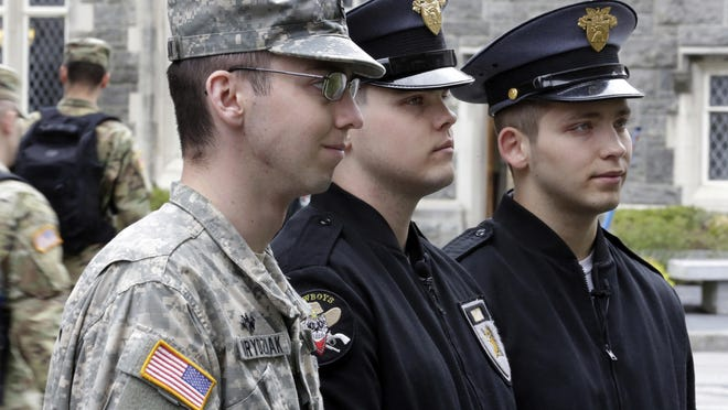 Cadet Noah Ogrydziak, left, and his twin brother Cadets Cole Ogrydziak, center, and Sumner Ogrydziak, are shown last month at the U.S. Military Academy at West Point, N.Y. The three Texas brothers will graduate with the Class of 2017 on May 27.