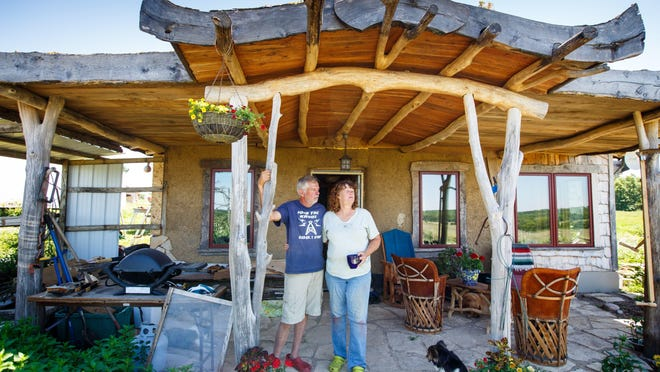 John Freeberg and Susan Walch used materials largely from their land to build a small off-the-grid home outside Fairfield, Iowa.