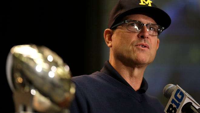 CORRECTS DATE - Michigan NCAA college football head coach Jim Harbaugh speaks at Big Ten Media Day in Chicago, Tuesday, July 25, 2017. (AP Photo/G-Jun Yam)