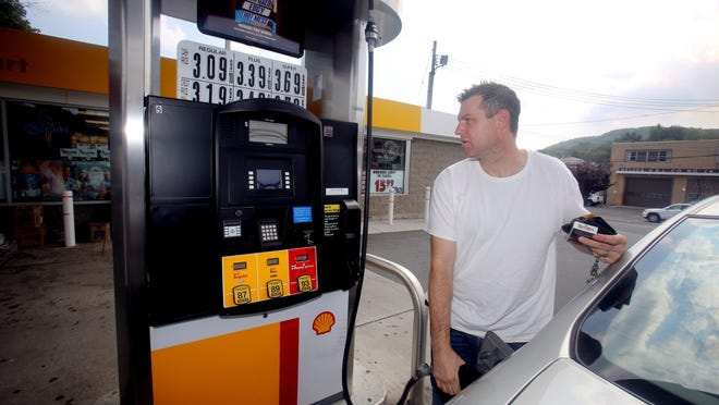 A man fills his gas tank at a gas station in Nyack.