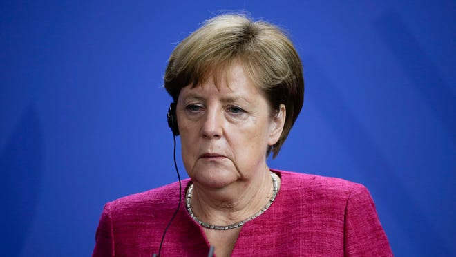 German Chancellor Angela Merkel attends a news conference with the Prime Minister of Spain Pedro Sanchez after talks at the chancellery in Berlin, Tuesday, June 26, 2018. (AP Photo/Markus Schreiber)