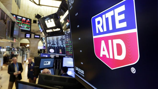 The logo for Rite Aid is displayed above a trading post on the floor of the New York Stock Exchange, Thursday, Aug. 9, 2018.
