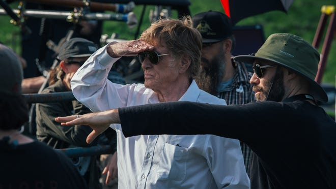 "Robert Redford and director David Lowery on the set of ""The Old Man & the Gun."""