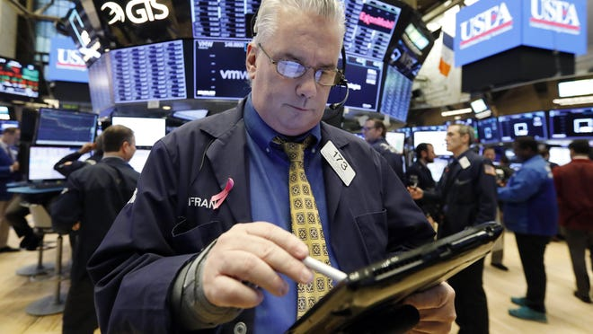 Trader Frank O'Connell on the floor of the New York Stock Exchange, Friday, Jan. 11, 2019.