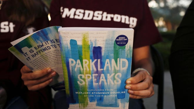 "Leni Steinhardt, 16, reads from a new book called ""Parkland Speaks: Survivors from Marjory Stoneman Douglas Share Their Stories,"" in Parkland, Florida."