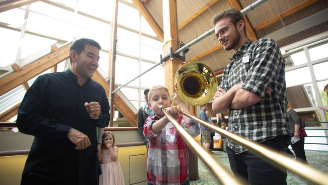 Rather than getting together in person, like at this 2019 instrument petting zoo event, the Eugene Symphony now offers musical interactions on its Virtual Hub in order to keep friends and families engaged during COVID-19 restrictions.