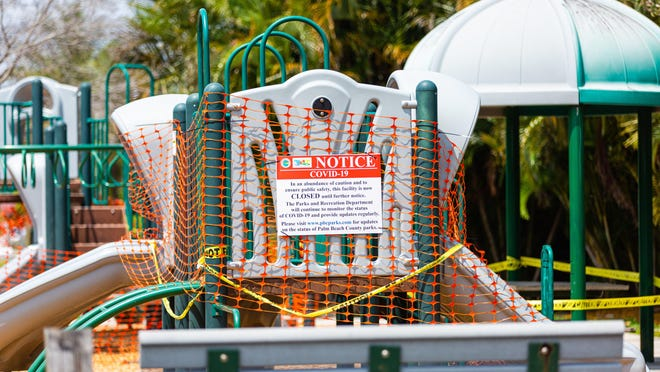 The playground equipment at Caroline Park in suburban West Palm Beach is cordoned due to the coronavirus pandemic, Wednesday, April 8, 2020.