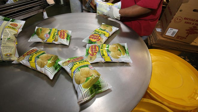 Potato chips are packed up on the assembly line at the Golden Flake Snack Foods factory on west Silver Springs Boulevard in Ocala, Fla., in 2016. The Golden Flake Ocala plant has been open since 1984 and the company also has a factory in Birmingham, AL. In addition to the potato chips made in many different flavors, the company also produces corn chips, tortilla chips, cheese curls and puffs, pork skins and popcorn.