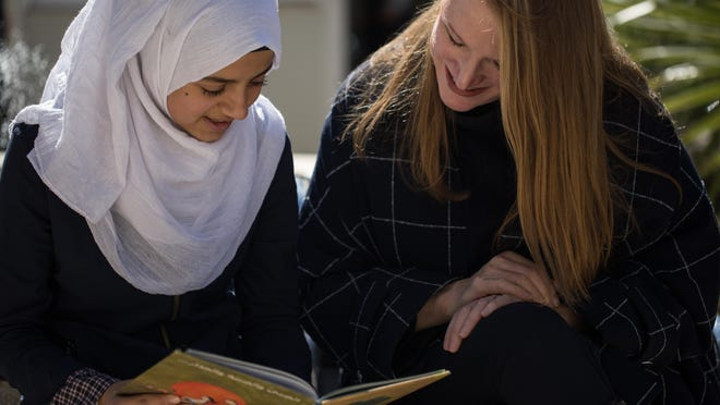 Founder and CEO Stacey Boyd, pictured on the right, started Olivela after attending Malala Yousafzai's 19th birthday.