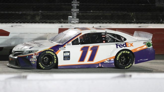 Denny Hamlin (11) drives during the NASCAR Cup Series auto race Wednesday, May 20, 2020, in Darlington, S.C. Hamlin won the race shortened by rain.