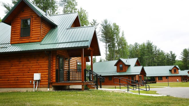 Pleasant Hill Lake Park will welcome the first guests to its 10 new log cabins starting Friday.