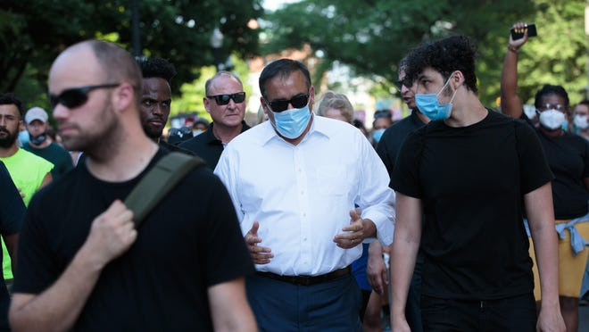 Columbus Mayor Andrew J. Ginther, marching with protesters on June 2, has instituted a policy in which the city reviews and approves all news releases, public statements and social media posts by the police department.