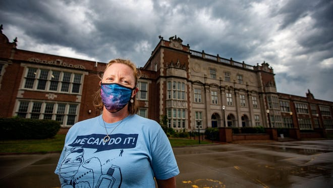 Nicole Cable, school nurse at RooseveltÕs High School stands for a portrait outside the school Thursday, Aug. 6, 2020.