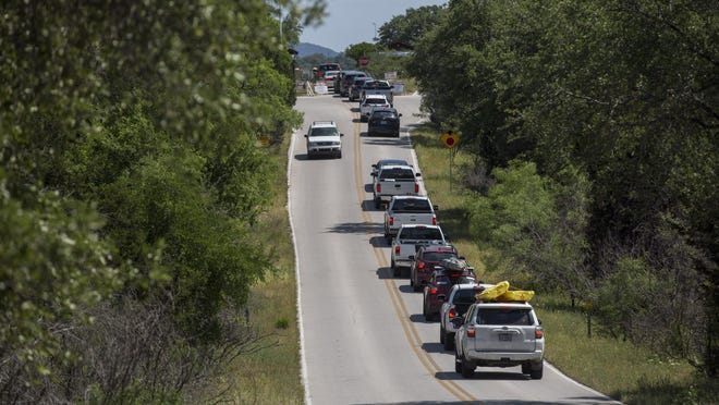 A line begins to form as park-goers wait to enter Pace Bend Park near Lake Travis on May 2. .