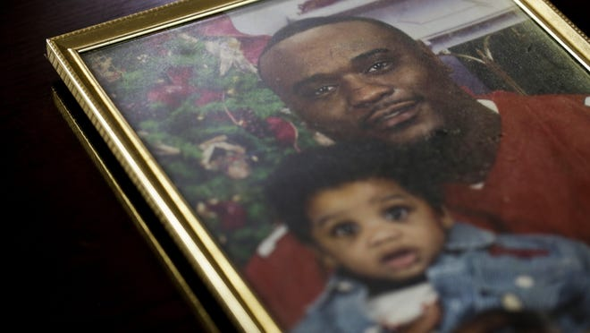A photo shows Javier Antonio Ambler II, who died in police custody in March 2019, and his oldest son J'vaughn. Authorities said Wednesday they won't release video of the arrest to protect their investigation.