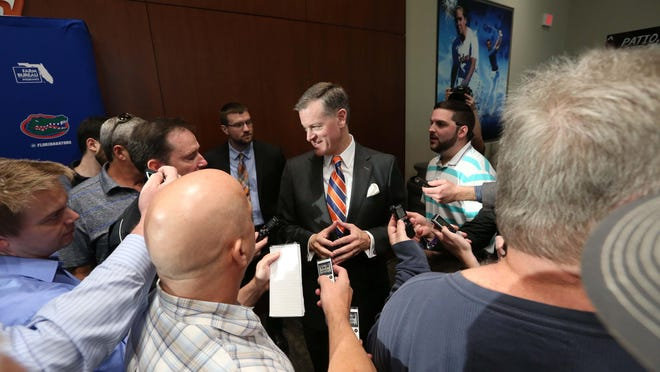 Florida athletic director Scott Stricklin, shown talking to media during head football coach Dan Mullen's introductory press conference in 2017, revealed last week that he had tested positive for the coronavirus. His was a mild case, he said.