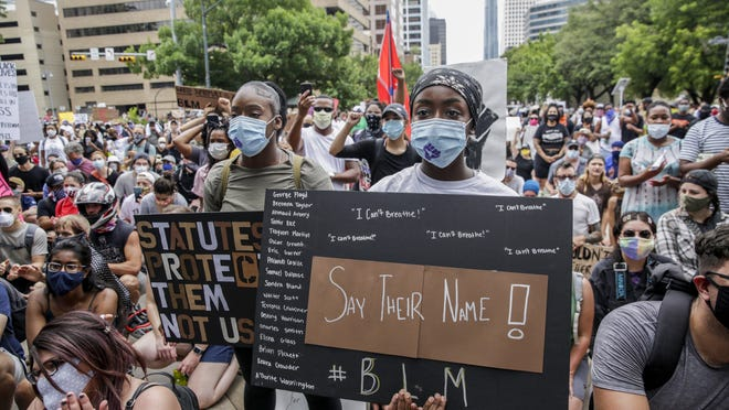 People gather by the thousands in protest against the Austin Police Department and the deaths of George Floyd and Michael Ramos in Austin on Sunday, May 31, 2020.